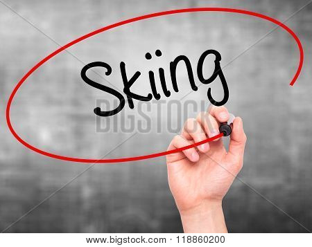 Man Hand Writing Skiing With Black Marker On Visual Screen