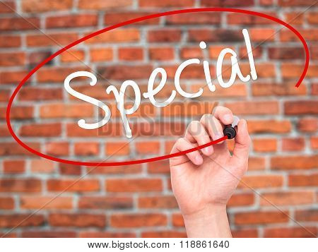 Man Hand Writing Special With Black Marker On Visual Screen