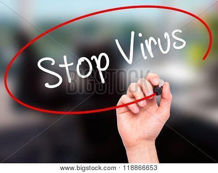 Man Hand Writing Stop Virus With Black Marker On Visual Screen