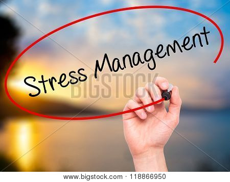 Man Hand Writing Stress Management With Black Marker On Visual Screen