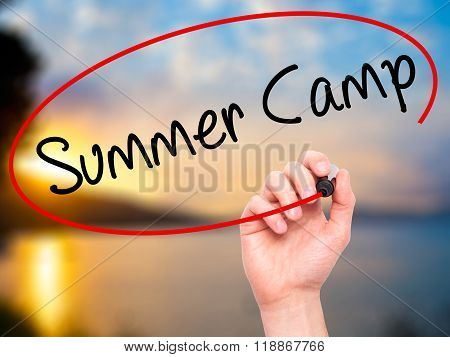 Man Hand Writing Summer Camp With Black Marker On Visual Screen