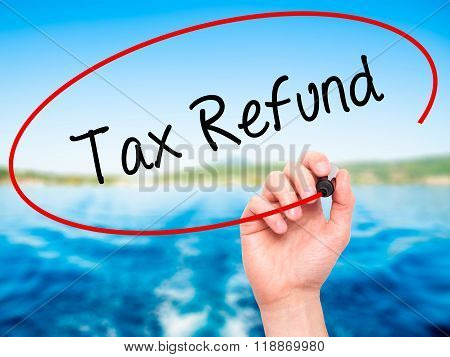 Man Hand Writing Tax Refund With Black Marker On Visual Screen