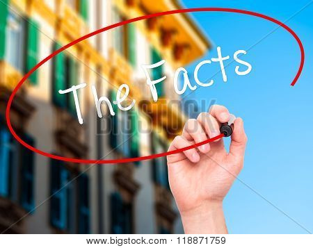 Man Hand Writing The Facts  With Black Marker On Visual Screen