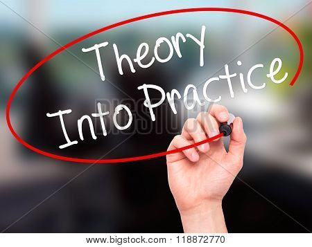 Man Hand Writing Theory Into Practice With Black Marker On Visual Screen