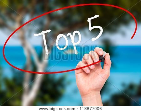Man Hand Writing Top 5 With Black Marker On Visual Screen