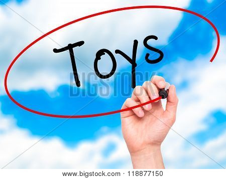 Man Hand Writing Toys  With Black Marker On Visual Screen