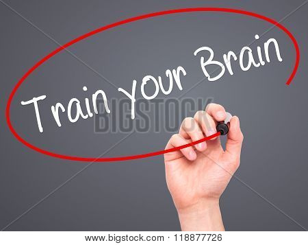 Man Hand Writing Train Your Brain With Black Marker On Visual Screen