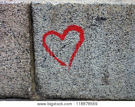 Hand painted red heart on a stone block