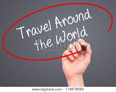 Man Hand Writing Travel Around The World With Black Marker On Visual Screen