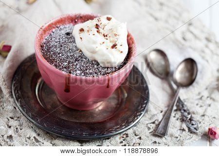 Homemade chocolate mug cake with icing sugar