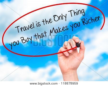 Man Hand Writing Travel Is The Only Thing You Buy That Makes You Richer With Black Marker On Visual