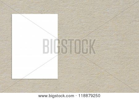 Blank folded paper poster hanging on paper taxture wallTemplate mock up for adding your design.