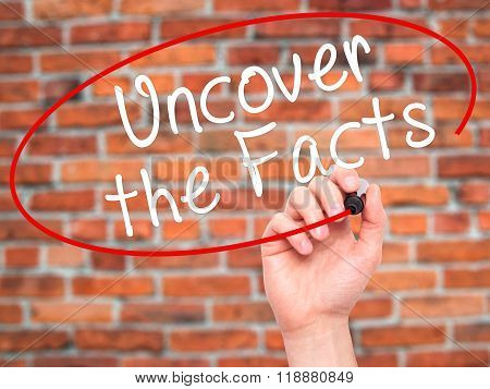 Man Hand Writing Uncover The Facts With Black Marker On Visual Screen