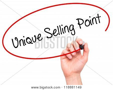 Man Hand Writing Unique Selling Point With Black Marker On Visual Screen