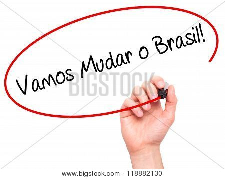 Man Hand Writing Vamos Mudar O Brasil! (let's Change Brazil In Portuguese)  With Black Marker On Vis