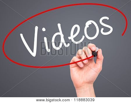Man Hand Writing Videos With Black Marker On Visual Screen