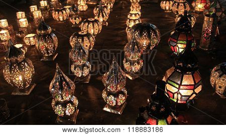 Row of traditional colored Moroccan candle lights