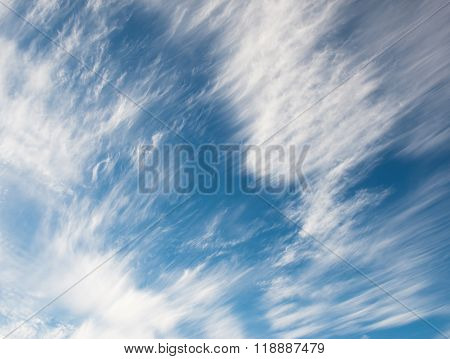 white spindrift clouds in the sky