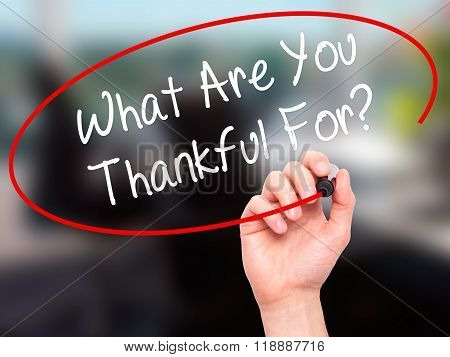 Man Hand Writing What Are You Thankful For? With Black Marker On Visual Screen
