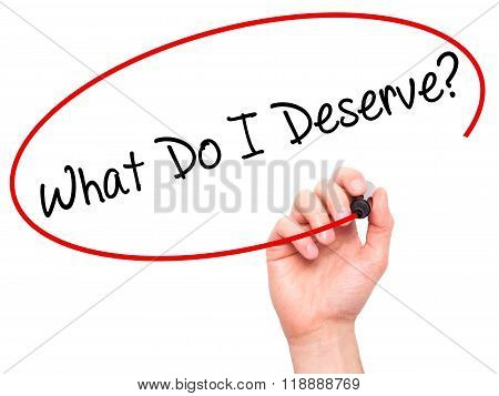 Man Hand Writing What Do I Deserve? With Black Marker On Visual Screen