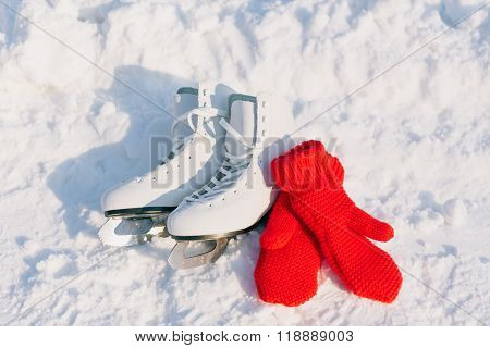 Figure skates in snow close-up