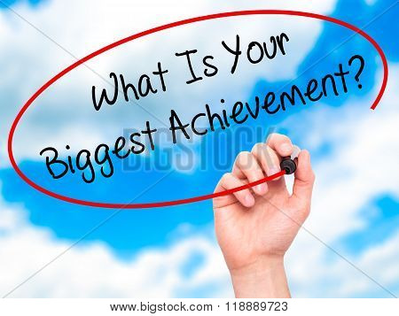 Man Hand Writing What Is Your Biggest Achievement? With Black Marker On Visual Screen