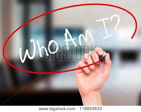 Man Hand Writing Who Am I? With Black Marker On Visual Screen