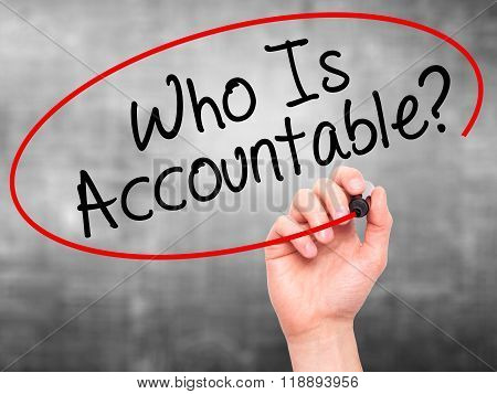 Man Hand Writing Who Is Accountable? With Black Marker On Visual Screen