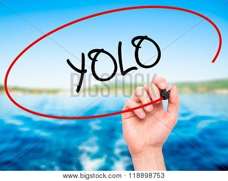 Man Hand Writing Yolo (you Only Live Once) With Black Marker On Visual Screen
