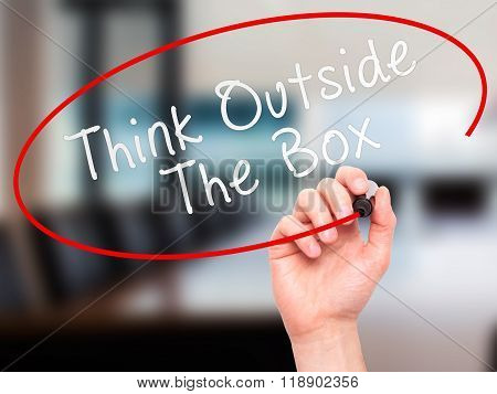 Man Hand Writing Think Outside The Box With Marker On Transparent Wipe Board