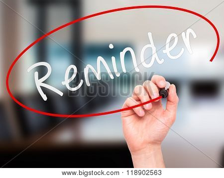 Man Hand Writing Reminder With Marker On Transparent Wipe Board