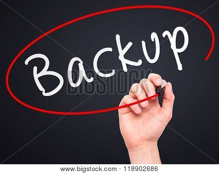 Man Hand Writing Backup With Marker On Transparent Wipe Board
