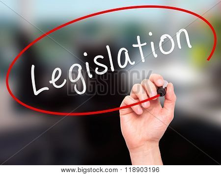 Man Hand Writing Legislation With Marker On Transparent Wipe Board