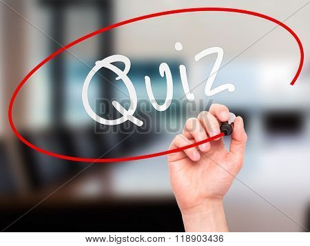 Man Hand Writing Quiz With Marker On Transparent Wipe Board