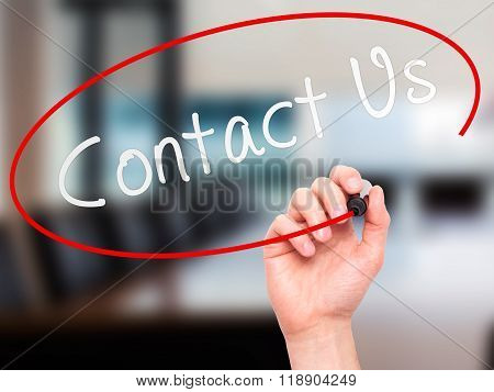 Man Hand Writing Contact Us With Marker On Transparent Wipe Board Isolated On Office