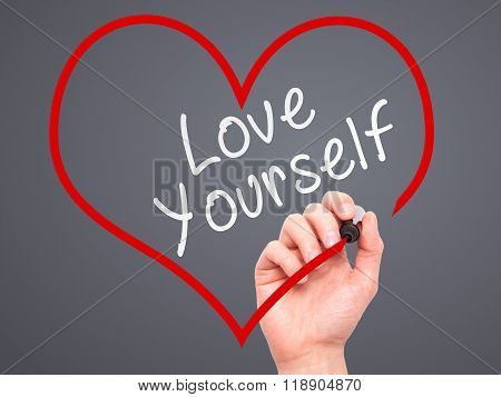 Man Hand Writing Love Yourself With Marker On Transparent Wipe Board, Inside Heart Shape