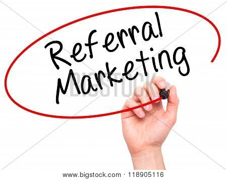 Man Hand Writing Referral Marketing With Marker On Transparent Wipe Board