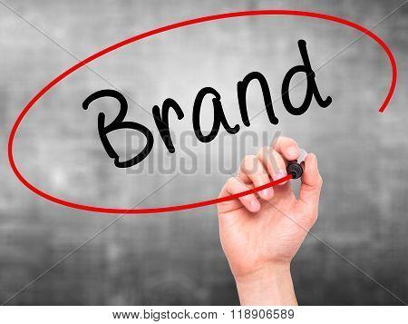 Man Hand Writing Brand On Visual Screen