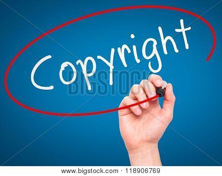 Man Hand Writing Copyright On Visual Screen