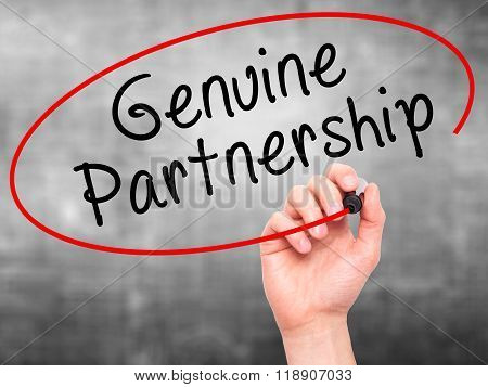 Man Hand Writing Genuine Partnership With Marker On Transparent Wipe Board