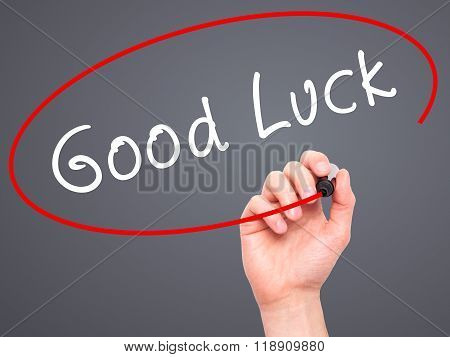 Man Hand Writing Good Luck With Marker On Transparent Wipe Board