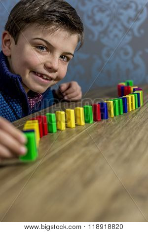 Boy Playing With Domino