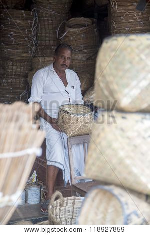 VARKALA, INDIA - OCTOBER 18, 2015: Unidentified bamboo basket maker in Varkala India. Bamboo- based industries in India provide employment to about 20 million people.