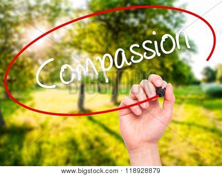 Man Hand Writing Compassion With Black Marker On Visual Screen