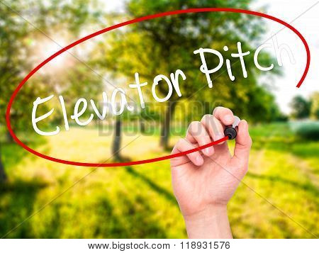 Man Hand Writing Elevator Pitch With Black Marker On Visual Screen