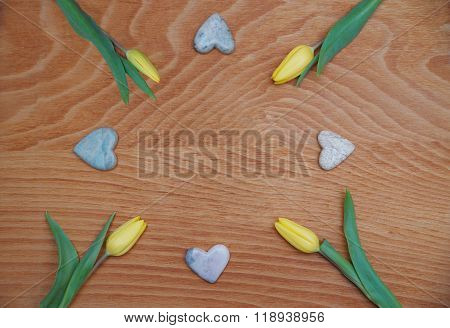 Red Stained Wooden Background With Tulips And Soapstone Hearts