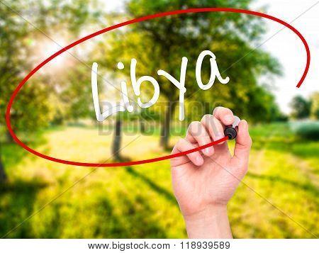 Man Hand Writing Libya  With Black Marker On Visual Screen