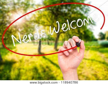 Man Hand Writing Nerds Welcome With Black Marker On Visual Screen