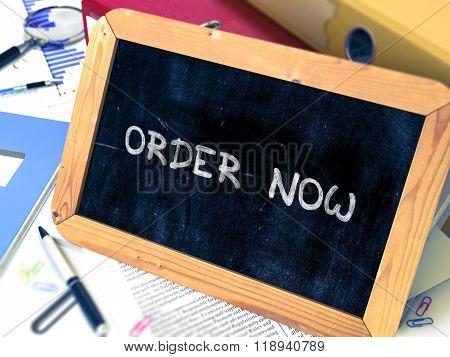 Handwritten Order Now on a Chalkboard.