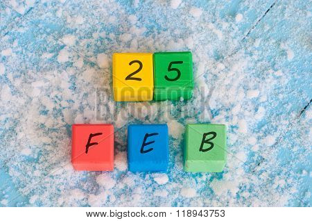 February 25th. Calendar date on color wooden cubes with marked Date 25 of february. Winter end conce
